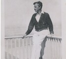 Eugene ONeill outdoors leaning against a deck railing