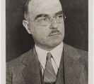 Bust length portrait of Thornton Wilder in suit and tie