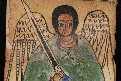 A detail of Ethiopic MSS 28 with an angel dressed in blue and green holding a sword in his right hand.