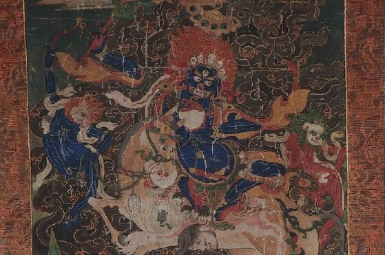 Tibet MSS 62, Box 50.  A Tibetan watercolor painting on cotton that depicts Palden Lhamo crossing a sea of blood riding side-saddle on a white mule.
