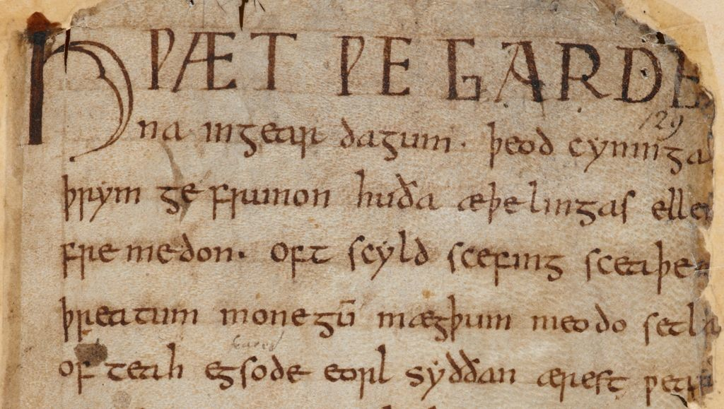 Image shows the first page of Beowulf in the manuscript damaged in the Cotton Fire.